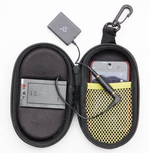 Opened NMDX Go speaker case, with attached Aluratek Bluetooth receiver and iPod Touch inside the sleeve. Note clip for hanging.