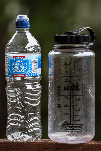 No brainer: 32 oz. Nalgene bottle weighs 6.2 oz. Twenty-four oz. (Mountain Spring) bottle weighs .7 oz. Nalgenes are great for sea kayak trips; backpacking, not so much.